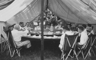 A lazy susan that accomodated twenty people was added during a later trip